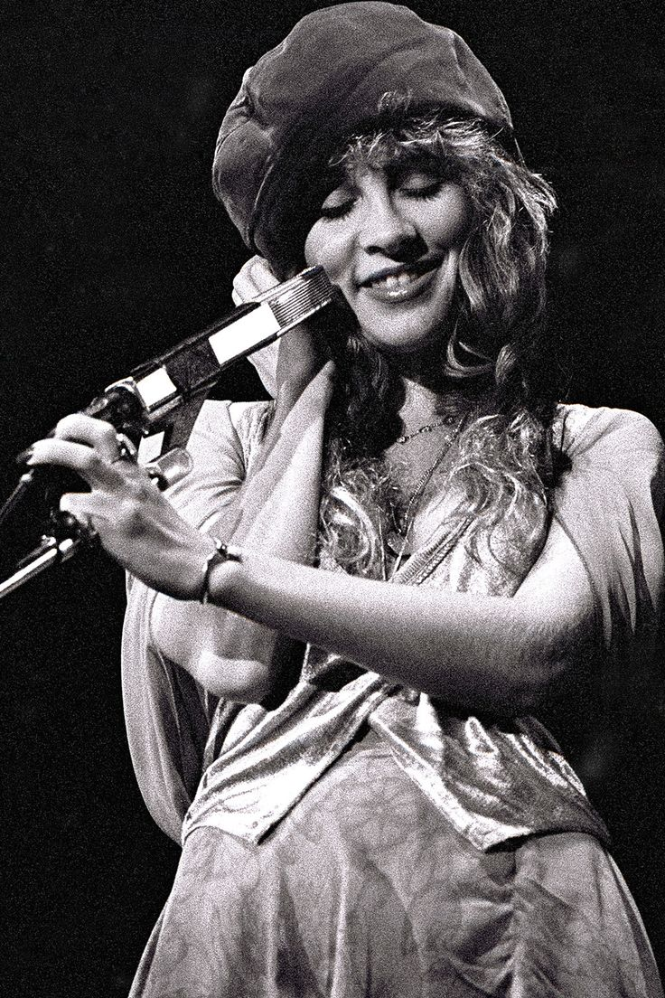 Stevie ~ ☆♥❤♥☆ ~   onstage, rocking a beret,  while performing with the other members of Fleetwood Mac, 1978