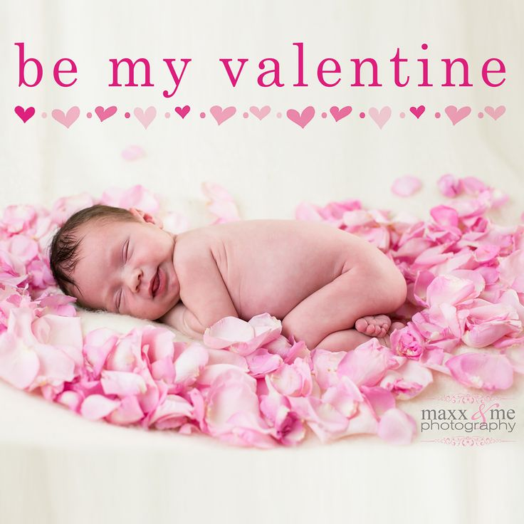 Newborn baby girl on a bed of pink rose petals for Valentine's Day. Love!