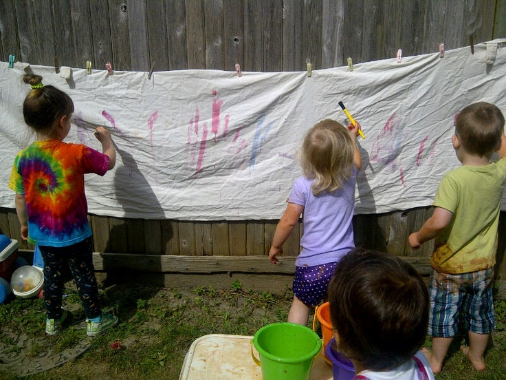 Hang a canvas cloth for an ongoing art project all summer as long as the weather is mostly sunny