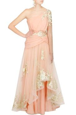 Featuring a peach one shoulder layered draped net gown with ivory and gold floral lace crystal embroidery on waist and shoulder and around hemline. It has chiffon underlayer and back zip closure by Suneet Verma Shop Now at www.carmaonlinesh... #carma #carmaonlineshop #shopnow #indian #fashion #designer #couture #pretty #sheek #classy #beauty #love #smile #ootn #luxuary #glamour #latest #peach #sheet #oneshoulder #layers #lightgold #beautiful