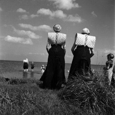 Women in traditional Spakenburg wear at the IJsselmeer (the Netherlands).