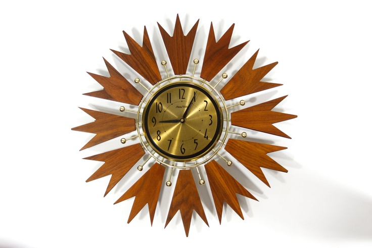 "Handsome midcentury clock made by Phinney Walker. 19.5"" in diameter. #sunburst clock #starburst clock"