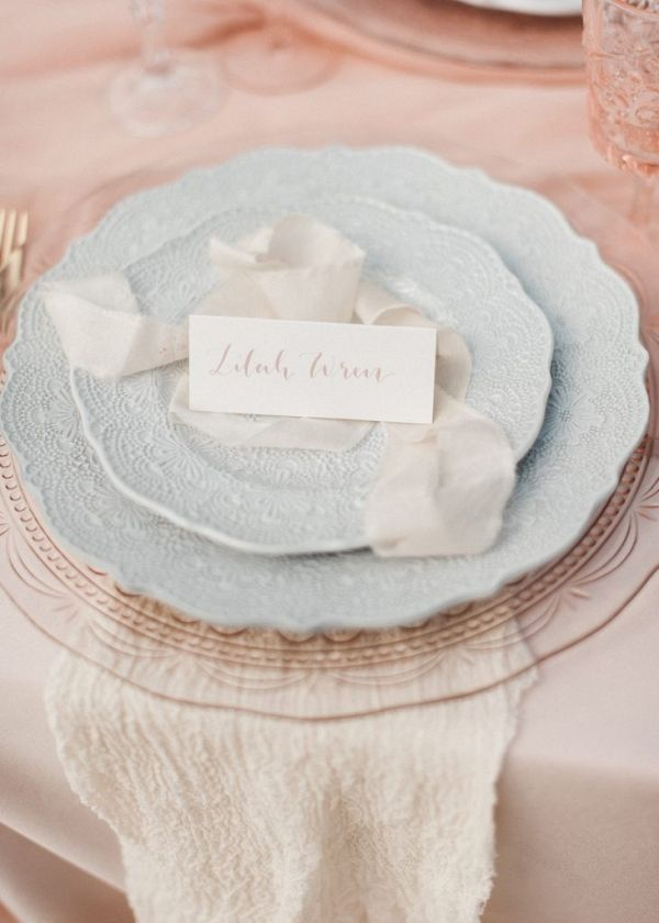 Ribbons and calligraphy place card create a place setting with beautiful tableware