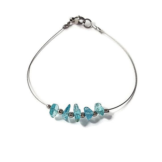 "✿ In the ""Shiny"" #Jewelry, you will find #dainty #silver #bracelet adorned with #Blue #Apatite (#natural #gemstone) and #silvery #beads. This delicate bracelet is #handmade with natural Blue Apatite chips and #stainless #steel beads on silver #wired steel  ☯ Blue Apatite is a #Stone of Manifestation. Blue Apatite encourage a positive outlook and a hopeful attitude and it enhances creativity.  #etsy #woman #fashion #shop #crystal #gift  https://www.etsy.com/listing/454861772/wire-jewelry-b"