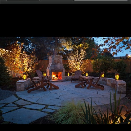 Patio with fire pit.  This is definitely what we need.  Awesome!