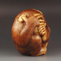 Netsuke (cowering monkey peering through fingers) by Sergei Osipov.