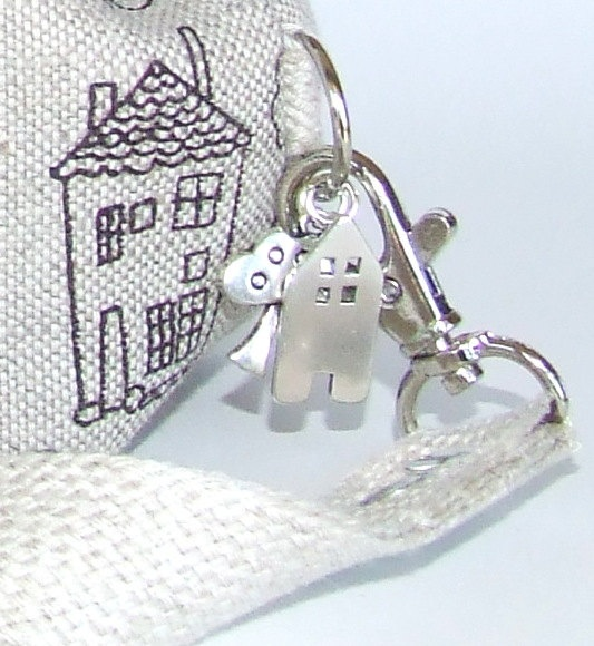 Attention to detail: our little house charm adorning a beautiful linen clutch.