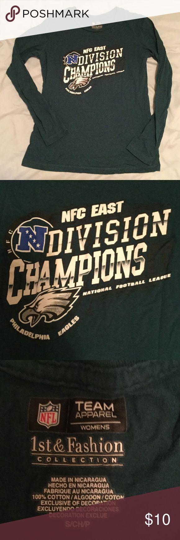 EAGLES NFC east champs shirt 😻👍🏻 Eagles NFC East Division Champions Long Sleeve Shirt. Official NFL Team Apparel. Size Small. Women's. LIKE NEW. NFL Team Apparel Tops Tees - Long Sleeve