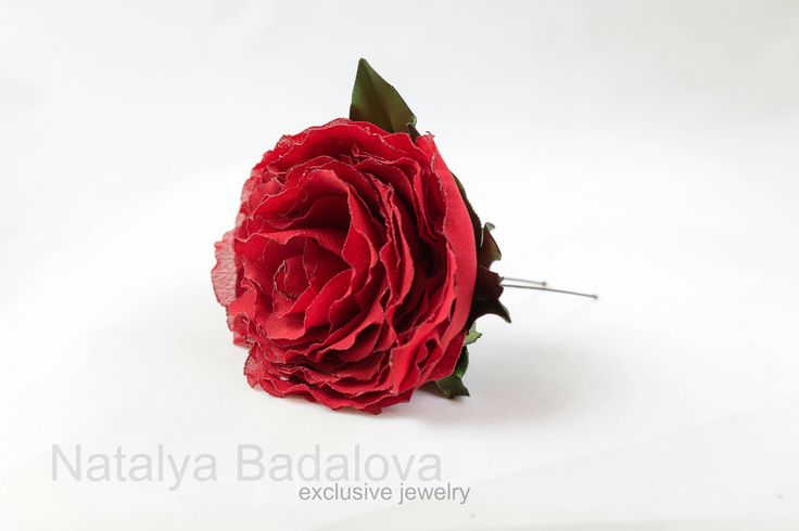 A personal favourite from my Etsy shop https://www.etsy.com/ie/listing/558543206/fabulous-red-rose-kanzashi-flower-hair