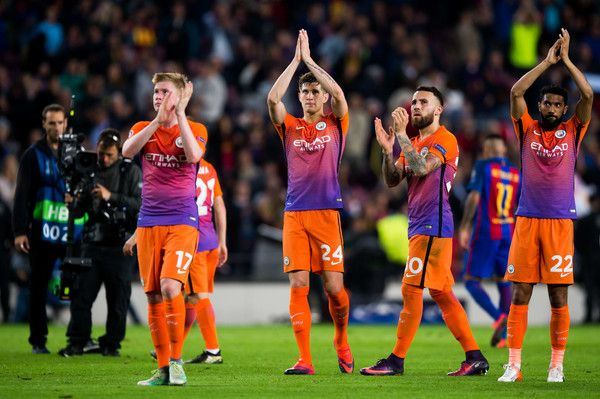 (L-R) Kevin De Bruyne, John Stones, Nicolas Otamendi and Gael Clichy of Manchester City FC applaud to their team's supporters at the end of the UEFA Champions League group C match between FC Barcelona and Manchester City FC at Camp Nou on October 19, 2016 in Barcelona, Catalonia.
