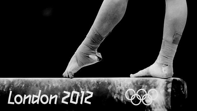 Huang Qiushuang of China competes on the balance beam in the Artistic Gymnastics women's Individual All-Around final