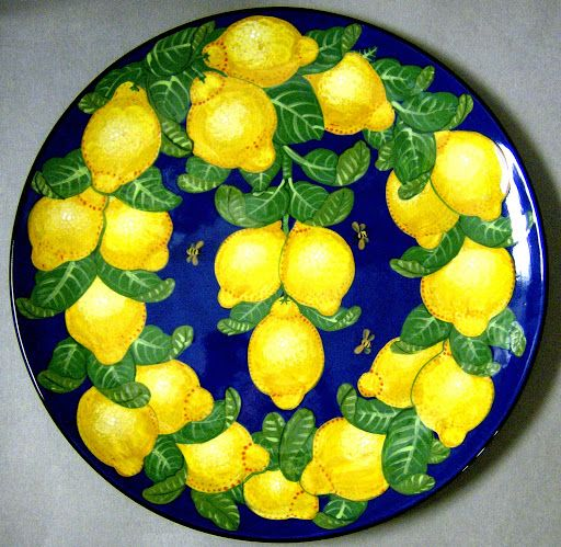 Large round lemon platter an old pattern painted by artist Geoff Graham of Cinnabar Ceramics in Vallejo, California.