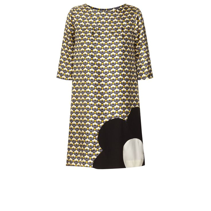 Orla Kiely: Silk twill half sleeve tunic in 'Sunset Flora' print with contrast flower detail at hem. Fully lined. Length: 83cm