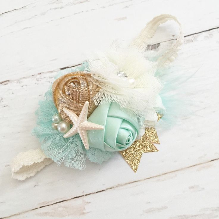 mint ivory gold lace feather sparkle starfish headband-beach mermaid summer headband by Goldfeatherboutique on Etsy https://www.etsy.com/listing/221051701/mint-ivory-gold-lace-feather-sparkle