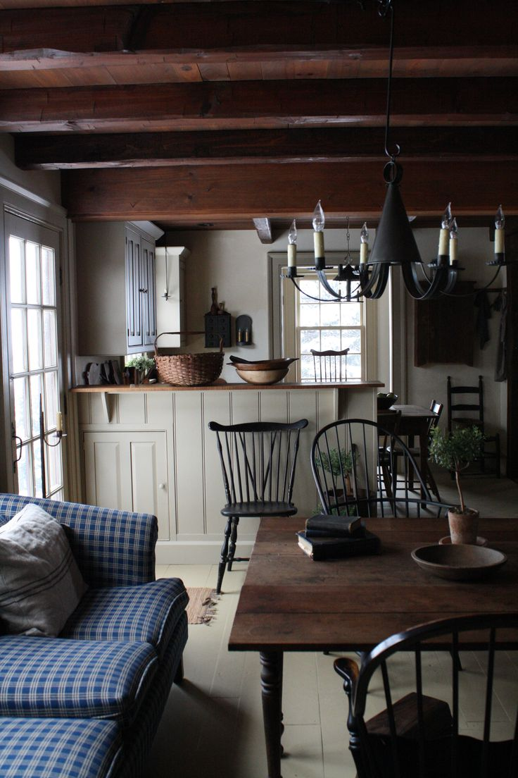 American style kitchen and living room - Farmhouse Interior Vintage Early American Farmhouse Showcases Raised Panel Walls Barn Wood Floor Exposed Beamed Ceiling And A Simple Style For