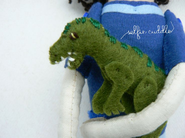 fabric handmade doll, portrait, small boy, selfie doll, face detail, embroidery, dino detail