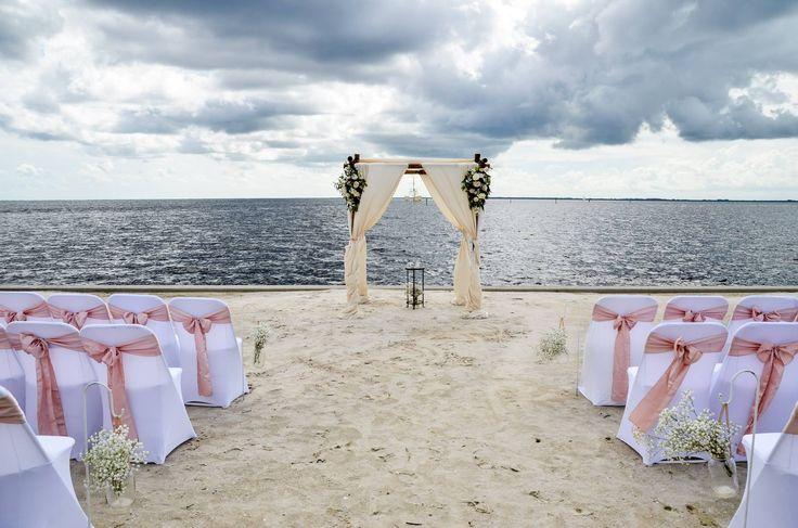 Rustic Beach Bride Wedding Package. Aged linens, bamboo arbor, custom floral arrangements, babies breath, mason jars, blush sashes, vintage chandelier. Ponce De Leon Park in Punta Gorda Florida.