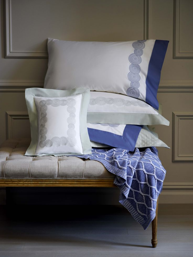 Embroidered Ponti bedding features a contrast-color cuff in either Silver Sage or Cornflower Blue for a stylish bed setting.