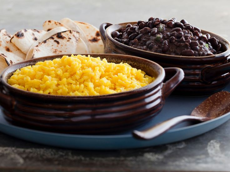 Spicy Black Beans and Yellow Rice : Tyler's spicy black beans get their kick from a jalapeno pepper. Pair them with long-grain rice that's been cooked with turmeric.