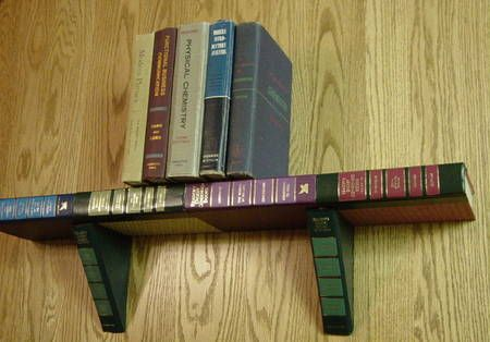 A bookshelf made from discarded books.... this looks like an awesome idea