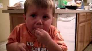 """3 Year Old Eating Atomic Warhead Candy  When my apraxic son was little we used to use tart foods to """"wake up his mouth"""" as per his SLP.   Tanner actually liked to eat lemon!    more on the feeding and mealtime tips from my son's private preschool SLP Michelle Ortega on this page for oral motor dysfunction http://pursuitofresearch.org/2012/07/22/oral-motor-dysfunction-exercises-and-therapy-for-autism-and-apraxia/ and this page for picky eaters…"""
