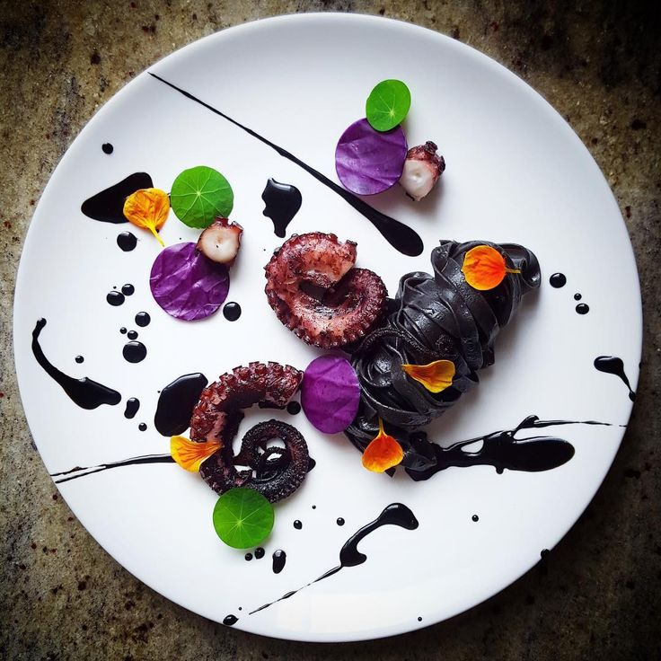 Octopus, purple cabbage, tagliolini, squid ink sauce and nasturtium