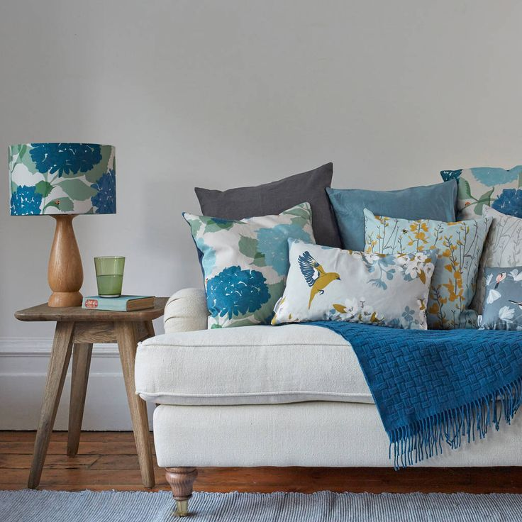 This high quality, digitally printed cushion features a bright blue and yellow floral with hidden bees.Why not try pairing with one of our matching lampshades too? Your cushion will arrive wrapped, free of charge, in blue tissue paper and tied up with a ribbon. All of our cushions are printed in the UK because we are proud to be part of British manufacturing. If an item is out of stock, please contact us for an expected delivery date for the item.The simplicity of this design makes it a…