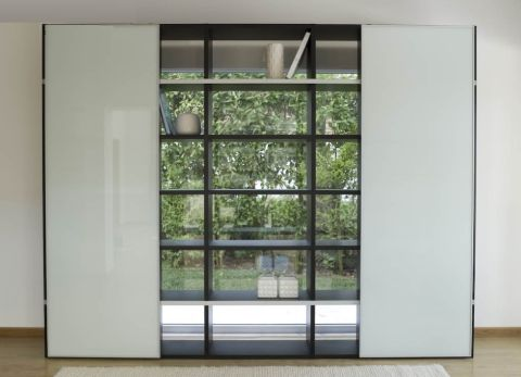 pombol large bookcase with white glass doors stylishly positioned here in front of a window imagine what it would look like with pretty glass storage