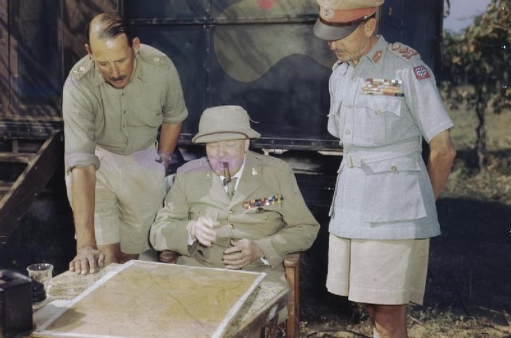 WINSTON CHURCHILL AT EIGHTH ARMY HEADQUARTERS IN ITALY, 26 AUGUST 1944. The Prime Minister, the Rt Hon Winston Churchill, MP, discussing the battle situation with the Commander of the Eighth Army Lieutenant General Sir Oliver Leese (left) and the Supreme Allied Commander of the Mediterranean, General Sir Harold Alexander, at General Leese's headquarters in the Monte Maggio area.