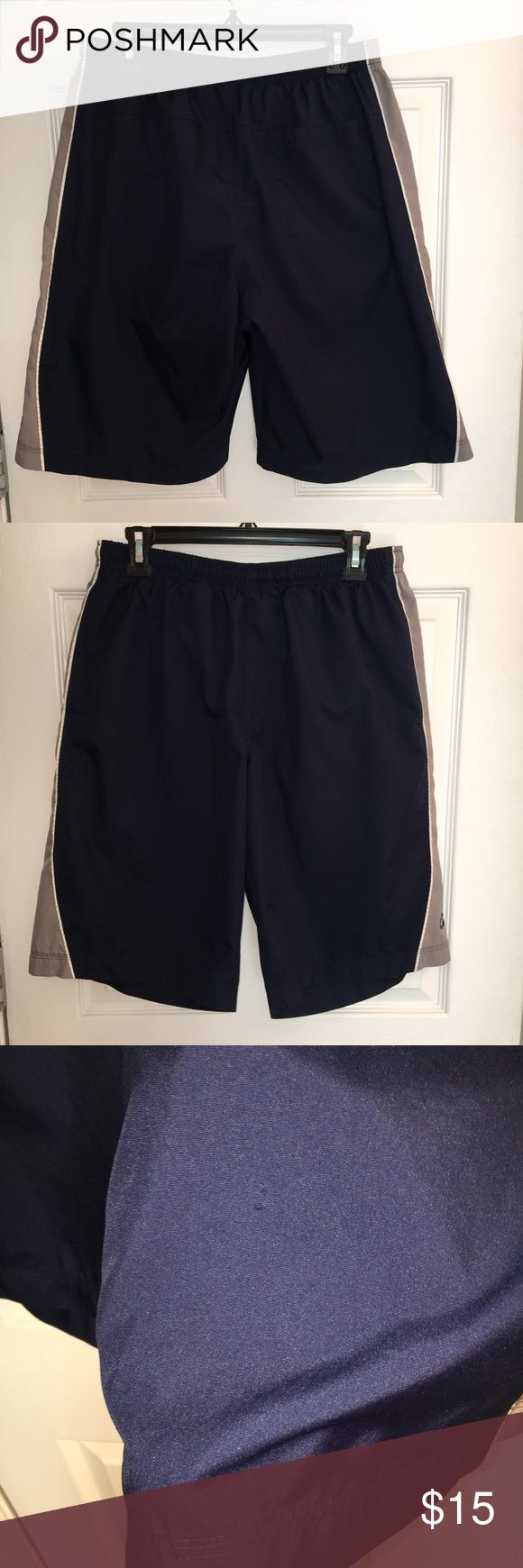 Men's navy & grey Nike swim shorts with liner Men's navy & grey Nike swim shorts with liner. Size large. Tiny tear as shown in image #3. Other than that, shirts are in great condition! Nike Shorts Athletic