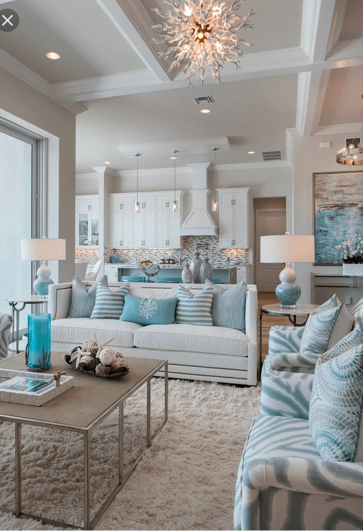 ... Atkins of Robb & Stucky created a coastal style interior in this Marco  Island home by using a color palette of blues, aquas and natural browns  accented ...