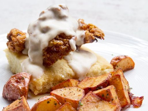The Brunch Dish: cheesy béchamel served over a chicken fried biscuit at Gather #chicago #brunch