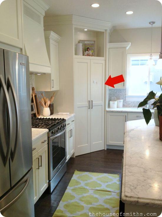 double door pantry entry opens to a full room behind all the kitchen appliances and cabinets.