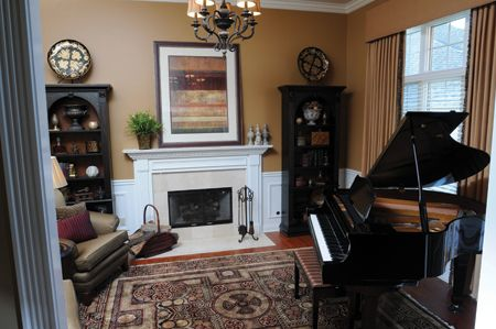 Small room with piano like the arch book shelves too for Piano for small space