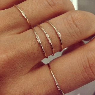 Jennie Kwon Designs / Three Bezel Ring. I love their dainty simplicity. Perfect for stacking.