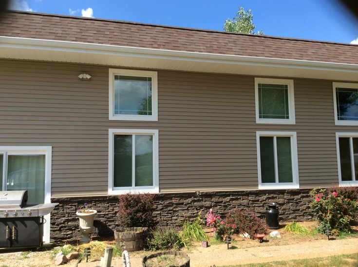 Beautiful siding genstone combination on this customer 39 s for Stucco and siding combinations