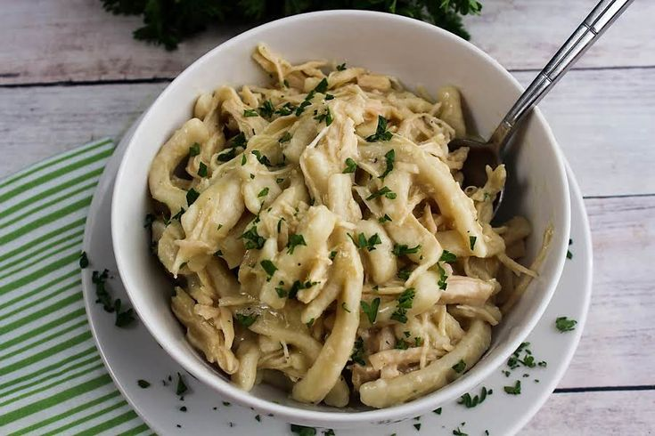 How to make comforting chicken and noodles in a Crock Pot. Salt & pepper chicken breasts and place in the bottom of Crock Pot. Spoon soup over the chicken. Cut butter into several pats and place pieces evenly over soup. Place lid on Crock Pot and turn to low. Cook for 6 hours.