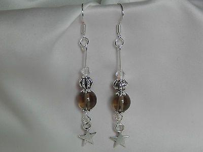 boucles d'oreilles - quartz fumé / cristal et breloque étoile €3.60