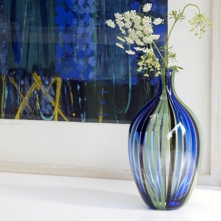 One of our beautiful hand blown Peacock Art Glass Vases. This one is truly stunning when the light shines though.