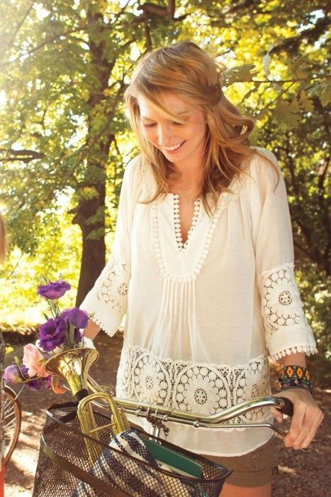 Blouse is very cute.. Bohemian style :) I have a shorter white peasant top but its very plain, I want one like this