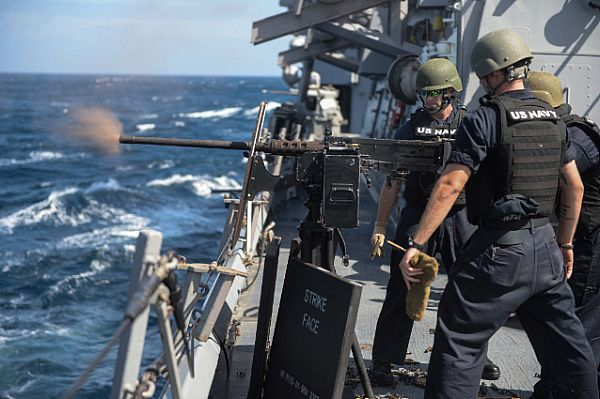 ATLANTIC OCEAN (July 28, 2017) Sailors instruct midshipmen on how to fire the Mark 38 25 mm machine gun aboard the Arleigh Burke-class guided-missile destroyer USS Donald Cook (DDG 75) during a precision aim calibration live-fire exercise.  Donald Cook is forward-deployed to Rota, Spain, conducting its 6th patrol in the U.S. 6th Fleet area of operations. (U.S. Navy photo by Mass Communication Specialist 1st Class Theron J. Godbold/Released)
