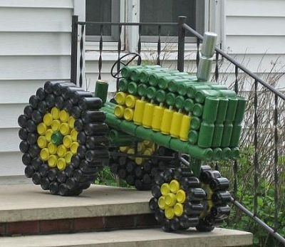 John Deere tractor made from recycled aluminum cans.  See more John Deere birthday party ideas at www.one-stop-party-ideas.com