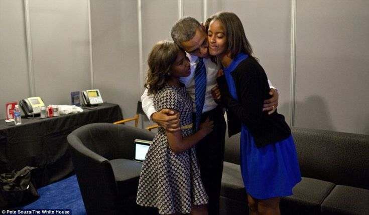 President Obama greets daughters Sasha and Malia at the Time Warner Cable Arena before delivering remarks at the Democratic National Convention in Charlotte.