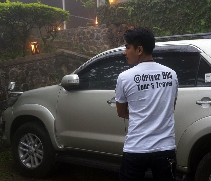 Means of transportation: A driver from @driverBDG pose in front of a car. The tour and travel company provide car and driver to drive to reach many destination around Bandung including the Tanakita camping ground in Cisaat, Sukabumi. (Photo by Icha Rahmanti)