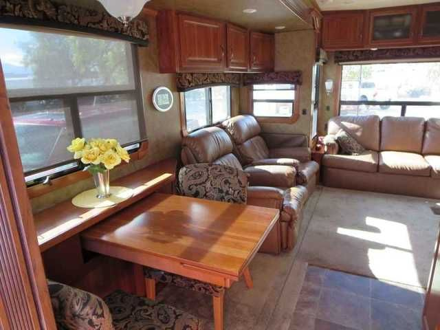 2014 Used Crossroads Redwood 38Gk Fifth Wheel in Arizona AZ.Recreational Vehicle, rv, 2014 Redwood 38GK 4 Slides; Full Body Paint; 6 point automatic leveling;; Heat Pump with A/C; 2nd A/C Unit 30,000 BTU; 12 Cu ft Side by side Refrigerator w/ Ice Maker; Convection Microwave; Dishwasher; Cabinets are Rustic Cherry Glaze; 2nd Sink in Bedroom; 5100 BTU Fireplace; Central Vac System; Water Filtration System; Two Power awnings with LED lighting; Dual Pane Windows; Generator Prep; Max Fan-Kitchen…