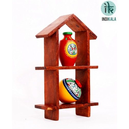 At www.indikala.com Hut shaped frame in sheesham wood. With set of two warli painted miniature pots. Will add color and life to your walls. A classy yet ethnic piece of art.