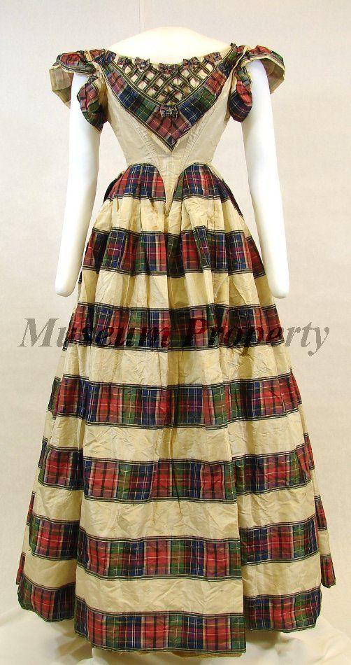 Tartan evening dress of Kate Acosta Graham, ca. 1858 Adult dress: White silk taffeta dress with woven tartan plaid stripes with the...