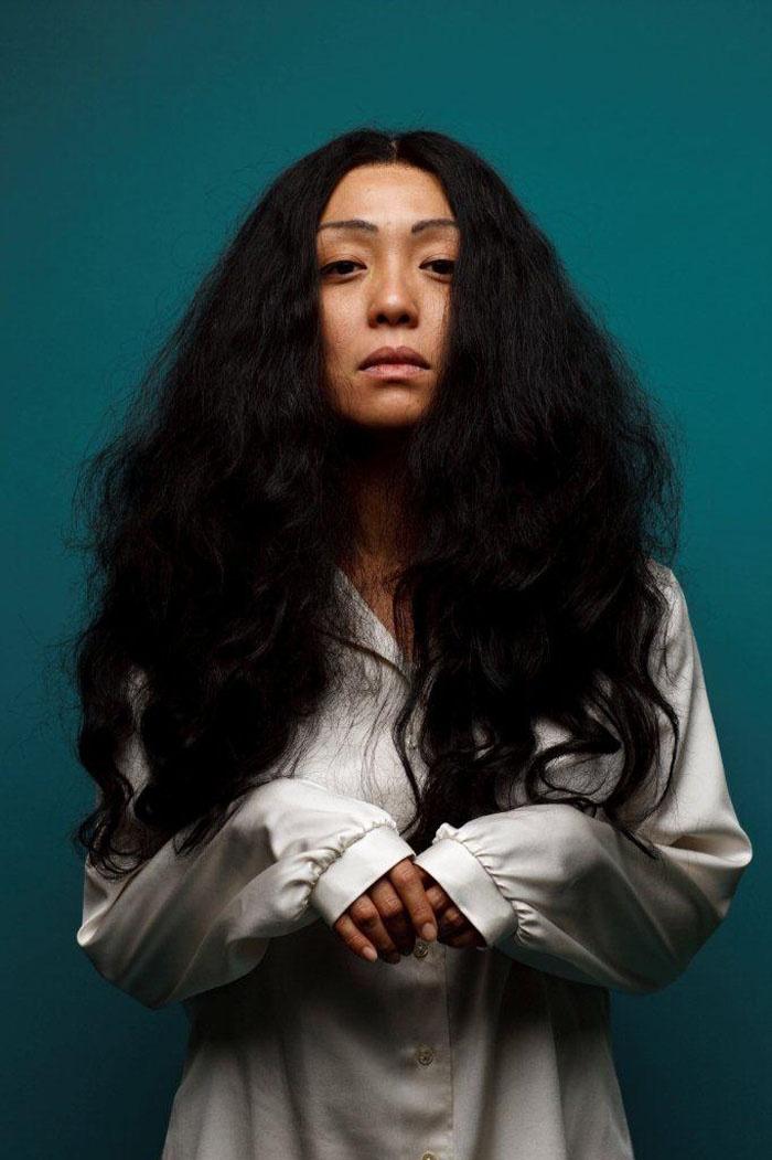 Naoko Mori as Yoko Ono - wild woman hair.