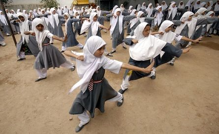 Muslim schoolgirls from St. Maaz high school practise Chinese wushu martial arts inside the school compound in the Indian city of Hyderabad. Girls from ages 10 to 16 participate in weekly sessions during school term.