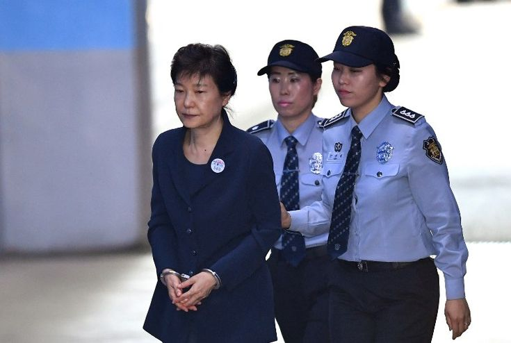 Government: This picture shows Park Geun-hye being arrested and her with police. She was accused of abusing her power as Prime Minister. She had the potential to look at classified documents without the Government's permission. Secret information could have gotten out to places that shouldn't know. (like North Korea) Many people lost confidence towards Park Geun-hye and feel like she is a very unsafe person. There are investigations going on now. Here is a video to. (27-1:44)